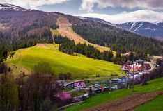 Tourist buses in Pylypets resort village. Pylypets, Ukraine - May 01, 2017: Tourist buses in Pylypets resort village. beautiful springtime landscape in Royalty Free Stock Photography