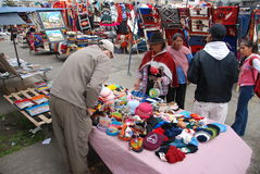 Tourist buying souvenirs in a market in Ecuador Royalty Free Stock Image