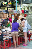 Tourist buys hat, Bangkok Royalty Free Stock Photos