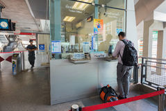 Tourist buys ticket to Suvarnabhumi airport in Bangkok Royalty Free Stock Image