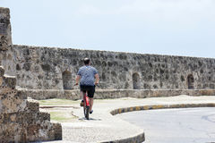 Tourist and Bycicle in Cartagena de Indias. CARTAGENA, COLOMBIA - JULY 2015. Tourist man with a bicycle in Cartagena de Indias Royalty Free Stock Images