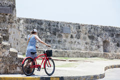 Tourist and Bycicle in Cartagena de Indias. CARTAGENA, COLOMBIA - JULY 2015. Tourist woman with a bicycle in Cartagena de Indias Stock Photography