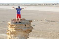 Tourist on camel head rock Stock Photos