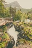 Tourist with camera on Gudbrandsjuvet waterfall, Norway Royalty Free Stock Photo