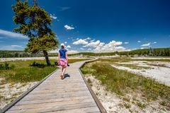 Tourist with camera hiking in Yellowstone Royalty Free Stock Photos