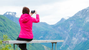 Tourist with camera looking at scenic view in mountains Norway Royalty Free Stock Photos