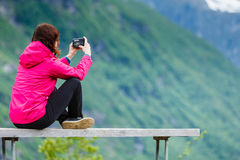 Tourist with camera looking at scenic view in mountains Norway Stock Images