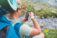 Tourist with camera in mountains Royalty Free Stock Photo
