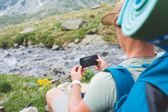 Tourist with camera in mountains Royalty Free Stock Photography