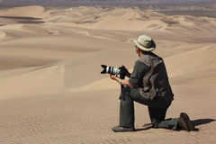 Tourist with camera - Namib Desert - Namibia stock photos