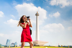 Tourist with camera sightseeing at Monumen Nasional Stock Image