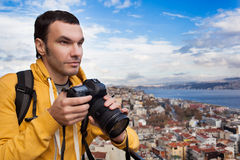 Tourist with camera take a picture. Tourist with a camera photographing landscape in Istanbul, Turkey. Landscape looked like a classic European city Royalty Free Stock Photo