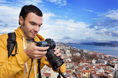 Tourist with camera take a picture Stock Image