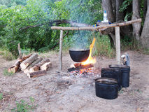 Tourist camp. The image of tourist camp and dinner cooked under the fire Royalty Free Stock Images
