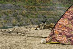 Tourist camp on the bank of a flooded quarry royalty free stock image