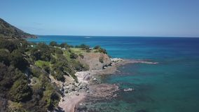 Tourist camp on cliff of coast near Mediterranean sea, aerial view. Beautiful nature stock footage