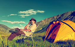 Tourist in camp Stock Images