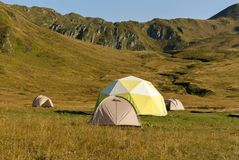 Tourist camp in the mountain valley Royalty Free Stock Photos