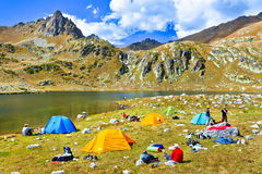 Hiking tourist camp in the mountains at the lake Royalty Free Stock Photo