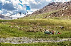 Tourist camp in the mountains, tent, tourists. Photo taken during a mountain hike on Kyrgyzstan Terskey-Alatau, pictured turichtichesky camp, tent, people, river Stock Images