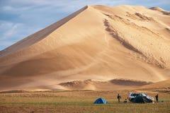 Tourist camp near barkhan in Mongolia sandy dune desert Mongol. MONGOL ELS SAND DESERT, MONGOLIA - JULY 05, 2018: Tourist camp near barkhan in Mongolia sandy stock image