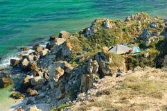 Tourist camp at rocky coast Stock Photos