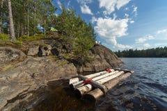 Tourist camp on the rocky shore Stock Photos