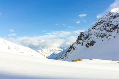 Tourist camp in the snowy mountains Stock Images