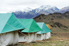 Tourist camp tents in mountains Royalty Free Stock Photos