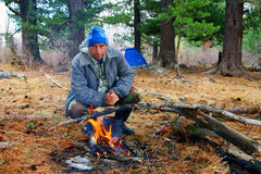 Tourist beside campfires Royalty Free Stock Image