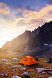 Tourist camping in the mountains. Tent in mountains at beautiful sunrise Stock Images