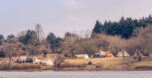 Tourist camping at Tanuki lake , Fujinomiya , Shizuoka, Japan. Tourist camping at Tanuki lake one of the best landmark of mt.Fuji view , Fujinomiya , Shizuoka stock photos