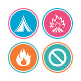 Tourist camping tent sign. Fire flame icons. Tourist camping tent icon. Fire flame and stop prohibition sign symbols. Colored circle buttons. Vector Royalty Free Stock Photos