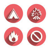 Tourist camping tent sign. Fire flame icons. Tourist camping tent icon. Fire flame and stop prohibition sign symbols. Pink circles flat buttons with shadow Royalty Free Stock Photo
