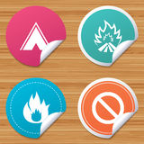 Tourist camping tent sign. Fire flame icons. Round stickers or website banners. Tourist camping tent icon. Fire flame and stop prohibition sign symbols. Circle Royalty Free Stock Photos