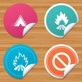 Tourist camping tent sign. Fire flame icons. Round stickers or website banners. Tourist camping tent icon. Fire flame and stop prohibition sign symbols. Circle Royalty Free Stock Photo