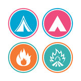 Tourist camping tent signs. Fire flame icons. Tourist camping tent icons. Fire flame sign symbols. Colored circle buttons. Vector Royalty Free Stock Images