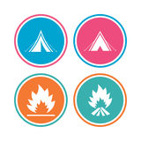Tourist camping tent signs. Fire flame icons. Tourist camping tent icons. Fire flame sign symbols. Colored circle buttons. Vector Stock Images