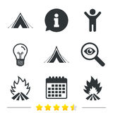 Tourist camping tent signs. Fire flame icons. Tourist camping tent icons. Fire flame sign symbols. Information, light bulb and calendar icons. Investigate Royalty Free Stock Photos