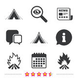 Tourist camping tent signs. Fire flame icons. Tourist camping tent icons. Fire flame sign symbols. Newspaper, information and calendar icons. Investigate Royalty Free Stock Photography