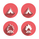 Tourist camping tent signs. Fire flame icons. Tourist camping tent icons. Fire flame sign symbols. Pink circles flat buttons with shadow. Vector Royalty Free Stock Images