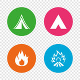 Tourist camping tent signs. Fire flame icons. Tourist camping tent icons. Fire flame sign symbols. Round buttons on transparent background. Vector Stock Image