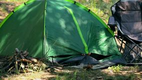 Tourist camping in the woods with a tent stock video