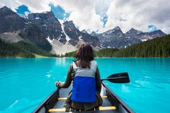 Tourist Canoeing on Moraine Lake in Banff National Park, Canadian Rockies, Alberta, Canada stock photography