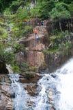 Tourist canyoning at Datanla waterfall, Vietnam Stock Photo