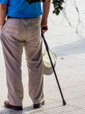 Tourist with cap and cane. A tourist with a geshtock and a cap as sun protection Royalty Free Stock Photo