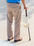Tourist with cap and walking stick Stock Photography