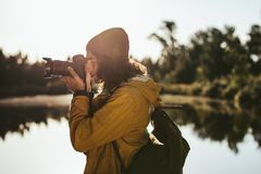 Tourist capturing the beauty of nature in camera royalty free stock photography