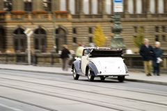Tourist Car. An old antique car gving tours in old town Prague Royalty Free Stock Photos