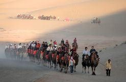Tourist caravan at mingsha sand dunes Stock Photography